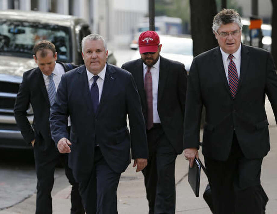 Marc Rylander, second left, spokesperson for the Texas attorney general, arrives to the Eldon B. Mahon U.S. Courthouse in Fort Worth, Texas on Friday, Aug. 12, 2016, where the federal lawsuit on transgender bathroom rules will be held. Texas and 12 other states will ask a federal judge to halt an Obama administration directive on bathroom rights for transgender students. (Nathan Hunsinger/The Dallas Morning News via AP) Photo: Nathan Hunsinger