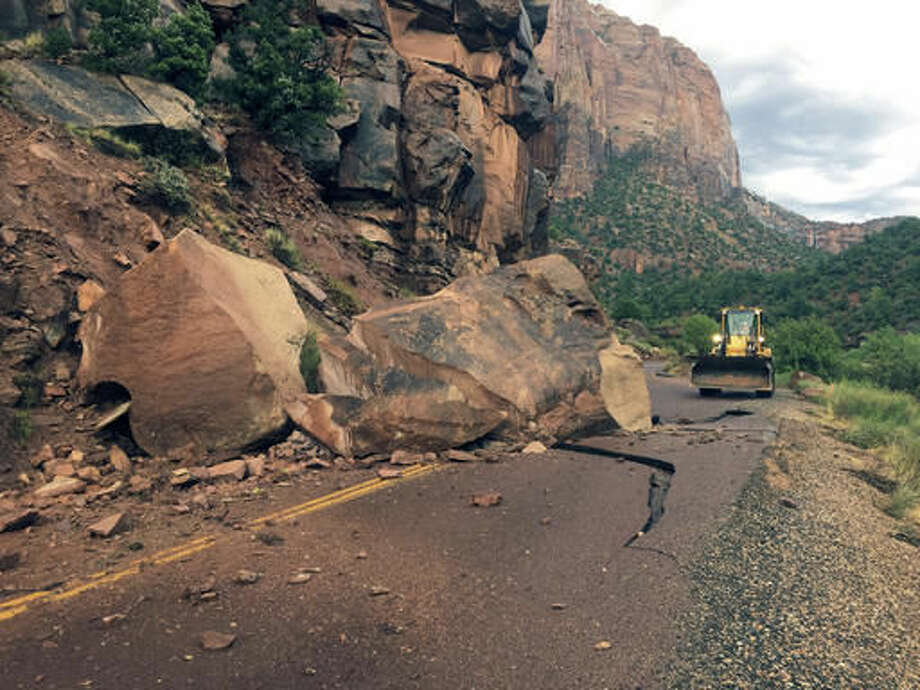 This Wednesday, Aug. 10, 2016 photo provided by the National Park Service shows the Zion- Mount Carmel Highway, State Route 9 closed, in Zion National Park after a boulder tumbled onto the roadway. Park spokeswoman Aly Baltrus says a geologist is exploring the best way to get the massive rock off the Zion-Mount Carmel Highway, where it fell on Wednesday evening. (National Park Service via AP) Photo: HOGP