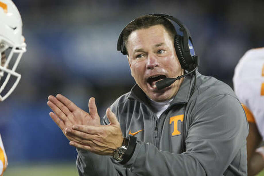 "FILE - In this Oct. 31, 2015, file photo, Tennessee head coach Butch Jones applauds his team after they scored during the second half of an NCAA college football game against Kentucky, in Lexington, Ky. This is the season Tennessee has been pointing to for years. ""We want expectations high,"" Tennessee coach Butch Jones said. ""That's why you come to the University of Tennessee. That's why you coach here. To me, it's a compliment of your program, no more, no less. Now it's what you do with it."" (AP Photo/David Stephenson, File) Photo: David Stephenson"