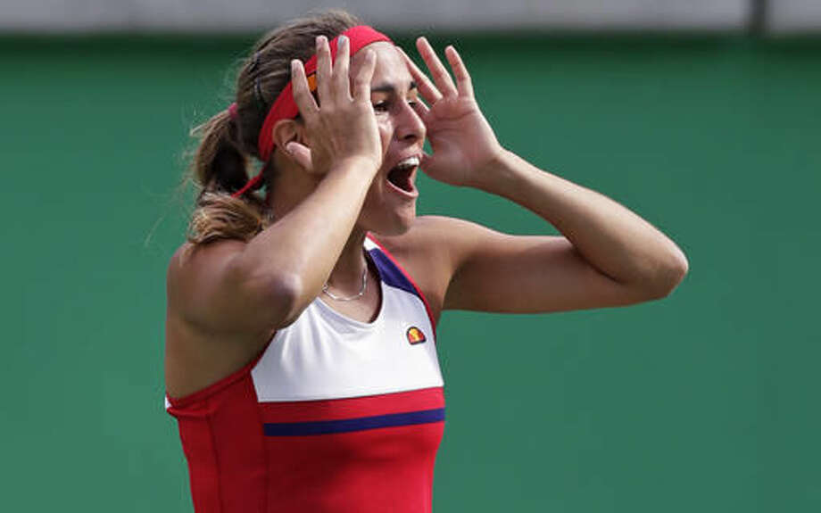 Monica Puig, of Puerto Rico, reacts after defeating Petra Kvitova, of the Czech Republic, during their semi-final round match at the 2016 Summer Olympics in Rio de Janeiro, Brazil, Friday, Aug. 12, 2016. (AP Photo/Charles Krupa) Photo: Charles Krupa