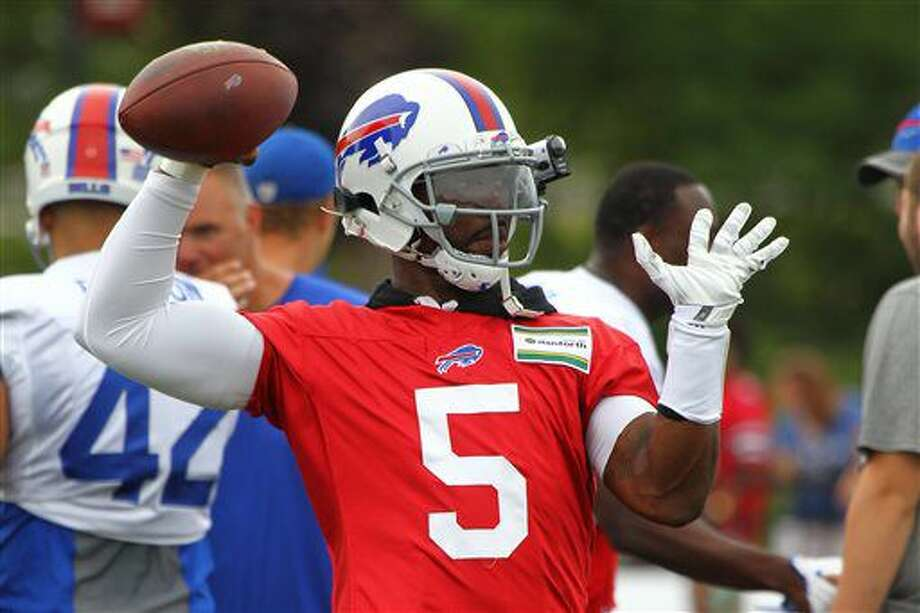 FILE - In this July 30, 2016, file photo, Buffalo Bills quarteback Tyrod Taylor throws a pass during NFL football training camp in Pittsford, N.Y. The Bills have placed their faith in quarterback Tyrod Taylor by signing him to a contract extension. (AP Photo/Jeffrey T. Barnes, File) Photo: Jeffrey T. Barnes