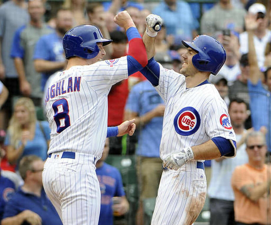 Chicago Cubs' Matt Szczur ,right, is greeted by Chris Coghlan (8) after hitting a two-run home run against the St. Louis Cardinals during the seventh inning of a baseball game, Friday, Aug. 12, 2016, in Chicago. (AP Photo/David Banks) Photo: David Banks