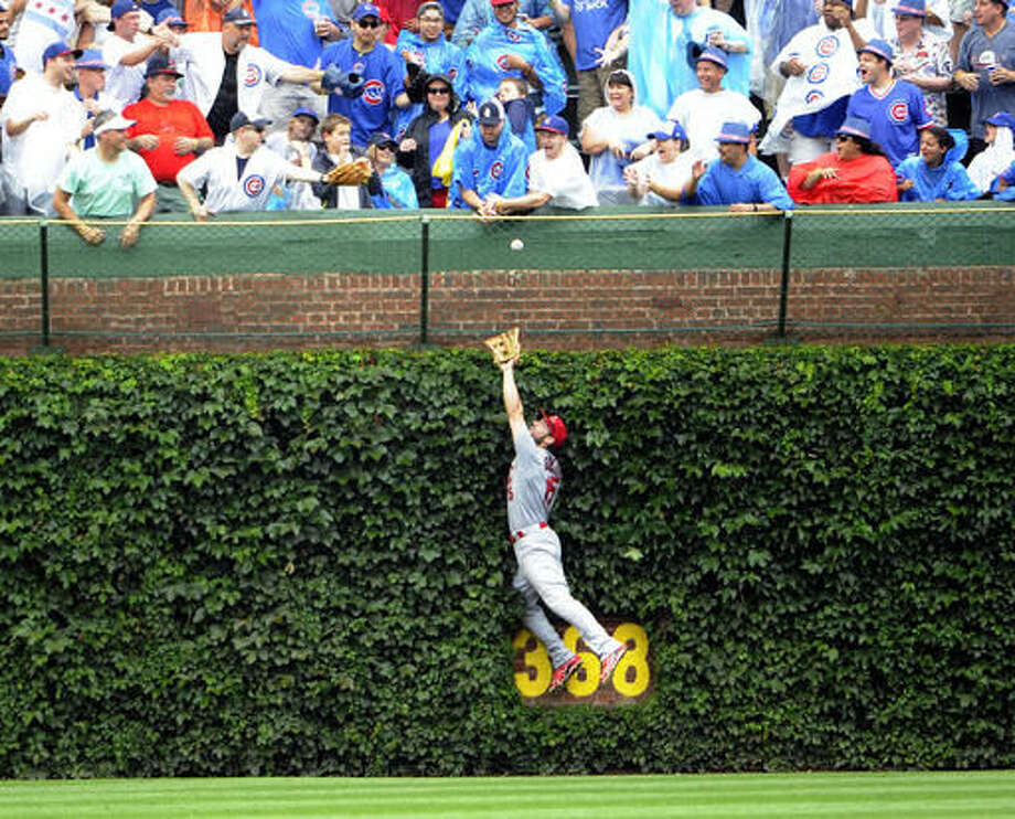St. Louis Cardinals center fielder Randal Grichuk (15) can't catch a solo home run hit by Chicago Cubs' Jorge Soler during the sixth inning of a baseball game, Friday, Aug. 12, 2016, in Chicago. (AP Photo/David Banks) Photo: David Banks