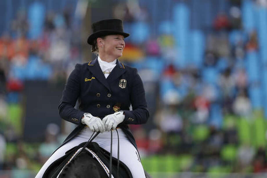 Germany's Isabell Werth, riding Weihegold Old, reacts after competing in the equestrian dressage competition at the 2016 Summer Olympics in Rio de Janeiro, Brazil, Friday, Aug. 12, 2016. (AP Photo/John Locher) Photo: John Locher