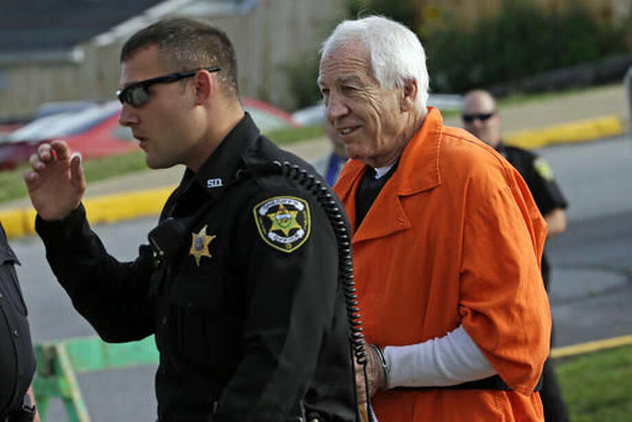Former Penn State University assistant football coach Jerry Sandusky, right, arrives at the Centre County Courthouse for an appeals hearing about whether he was improperly convicted four years ago, in Bellefonte, Pa. Friday, Aug. 12, 2016. Sandusky plans to take the stand and try to prove his claim he was wrongly convicted four years ago of sexually abusing 10 boys. (AP Photo/Gene J. Puskar) Photo: Gene J. Puskar