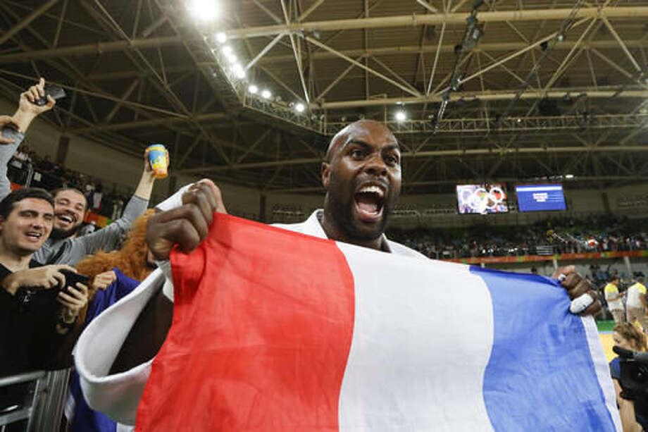 France's Teddy Riner celebrates after winning the gold medal during the men's over 100-kg judo competition at the 2016 Summer Olympics in Rio de Janeiro, Brazil, Friday, Aug. 12, 2016. (AP Photo/Markus Schreiber) Photo: Markus Schreiber