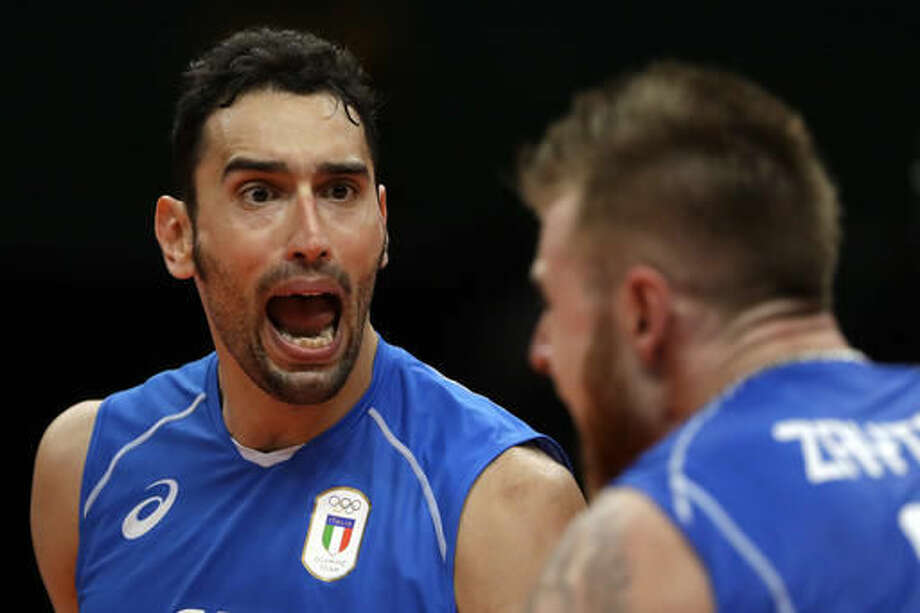 Italy's Emanuele Birarelli, left, and Ivan Zaytsev celebrate during a men's preliminary volleyball match against Brazil at the 2016 Summer Olympics in Rio de Janeiro, Brazil, Sunday, Aug. 14, 2016. (AP Photo/Matt Rourke) Photo: Matt Rourke