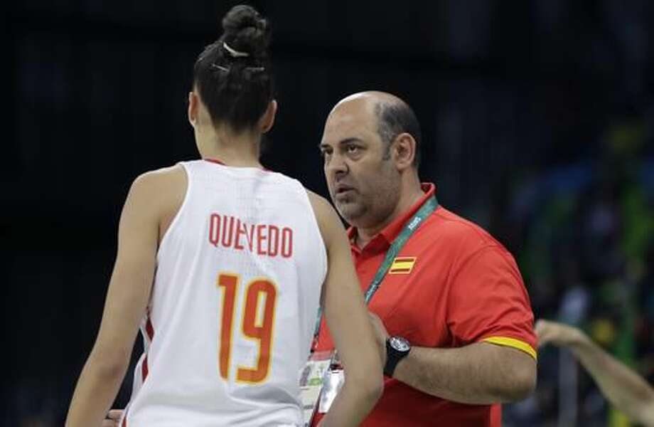 Spain head coach Lucas Mondelo talks with forward Laura Quevedo during the first half of a women's basketball game against Senegal at the Youth Center at the 2016 Summer Olympics in Rio de Janeiro, Brazil, Friday, Aug. 12, 2016. (AP Photo/Carlos Osorio) Photo: Carlos Osorio