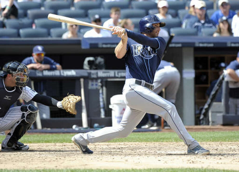 Tampa Bay Rays' Brad Miller hits a home run as New York Yankees catcher Austin Romine, left, looks on during the sixth inning of a baseball game Saturday, Aug. 13, 2016, at Yankee Stadium in New York. (AP Photo/Bill Kostroun) Photo: Bill Kostroun