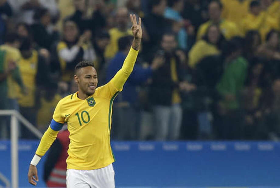 Brazil's Neymar celebrates after scoring his team's first goal with a free kick during a quarter-final match of the men's Olympic football tournament between Brazil and Colombia in Sao Paulo, Brazil, Saturday Aug. 13, 2016.(AP Photo/Leo Correa) Photo: Leo Correa
