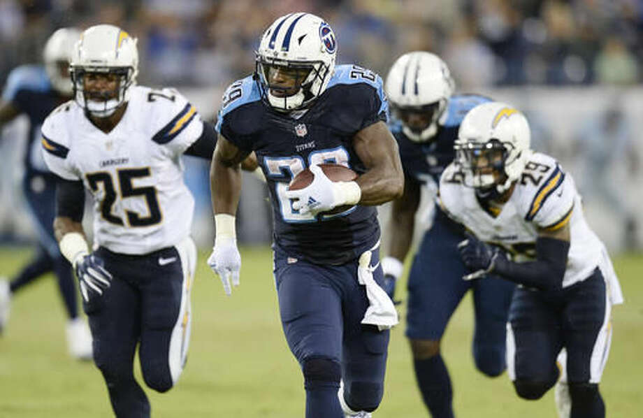 Tennessee Titans running back DeMarco Murray (29) runs past San Diego Chargers defensive back Darrell Stuckey (25) and San Diego Chargers cornerback Craig Mager (29) during the first half of an NFL preseason football game, Saturday, Aug. 13, 2016, in Nashville, Tenn. Murray ran 71-yards for a touchdown. (AP Photo/Mark Zaleski) Photo: Mark Zaleski