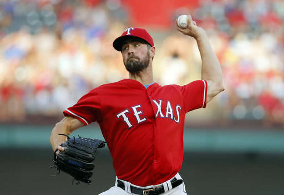 Texas Rangers starting pitcher Cole Hamels works against the Detroit Tigers in the first inning of a baseball game, Saturday, Aug. 13, 2016, in Arlington, Texas. (AP Photo/Tony Gutierrez) Photo: Tony Gutierrez