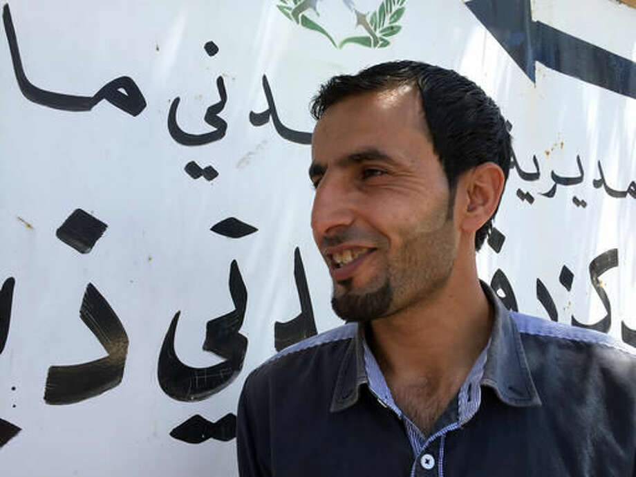 In this July 18, 2016 photo, Sabri Mashaaleh, 29, stands in the center of the small, remote farming town of Dhiban, Jordan, where he and other unemployed young men had pitched a protest tent over the summer, staging daily protests and demanding jobs before troops dispersed them by force. Rising unemployment, particularly among the young, has become Jordan's No. 1 problem, raising fears of radicalization in the pro-Western kingdom amid a deepening economic slump. (AP Photo/Karin Laub) Photo: Karin Laub