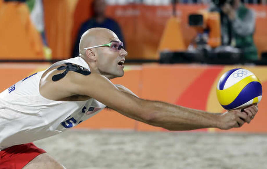 United States' Phil Dalhausser dives for the ball against Austria during a men's beach volleyball round of 16 match at the 2016 Summer Olympics in Rio de Janeiro, Brazil, Sunday, Aug. 14, 2016. (AP Photo/Marcio Jose Sanchez) Photo: Marcio Jose Sanchez