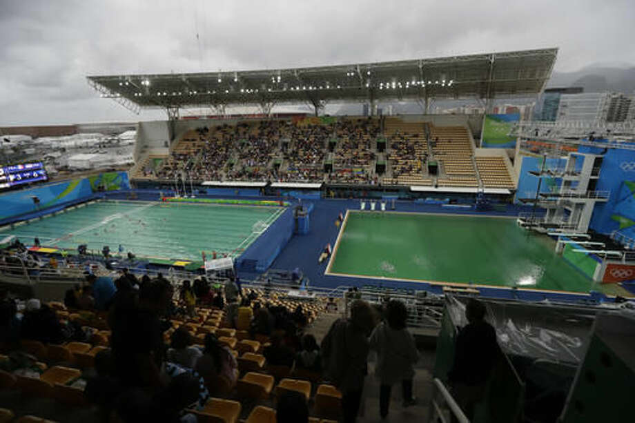 FILE - In this Aug. 10, 2016 file photo, the water of the diving pool at right appears a murky green as the water polo pool at left appears a greener color than the previous day during a preliminary round match between United States and France in the Maria Lenk Aquatic Center at the 2016 Summer Olympics in Rio de Janeiro, Brazil. Halfway through the Olympics, Rio de Janeiro is still struggling with a litany of problems that have underlined the challenges of taking the games away from their traditional territories, and made clear the games may not go to untested regions again in the near future. (AP Photo/Matt Dunham, File) Photo: Matt Dunham