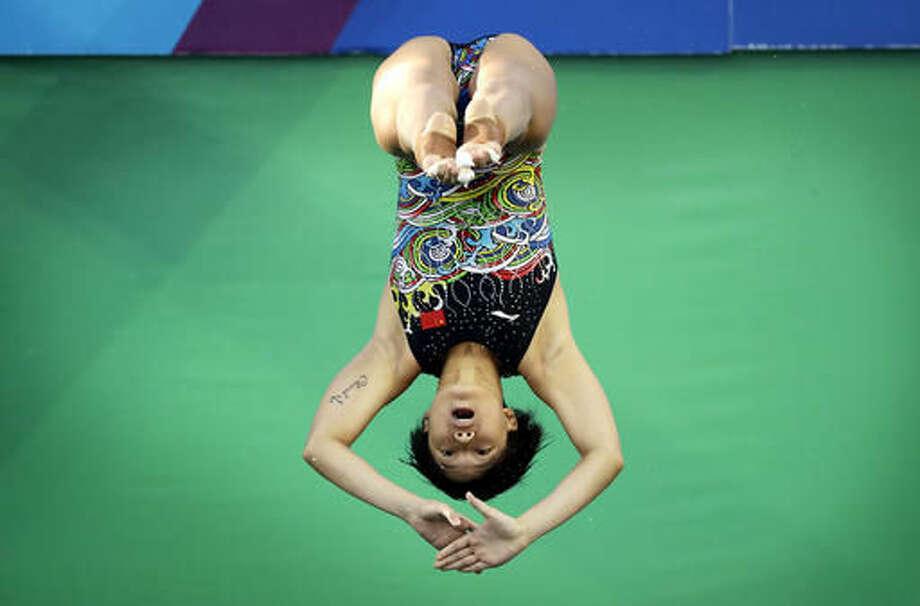 China's Shi Tingmao competes during the women's 3-meter springboard diving semifinal in the Maria Lenk Aquatic Center at the 2016 Summer Olympics in Rio de Janeiro, Brazil, Saturday, Aug. 13, 2016. (AP Photo/Wong Maye-E) Photo: Wong Maye-E