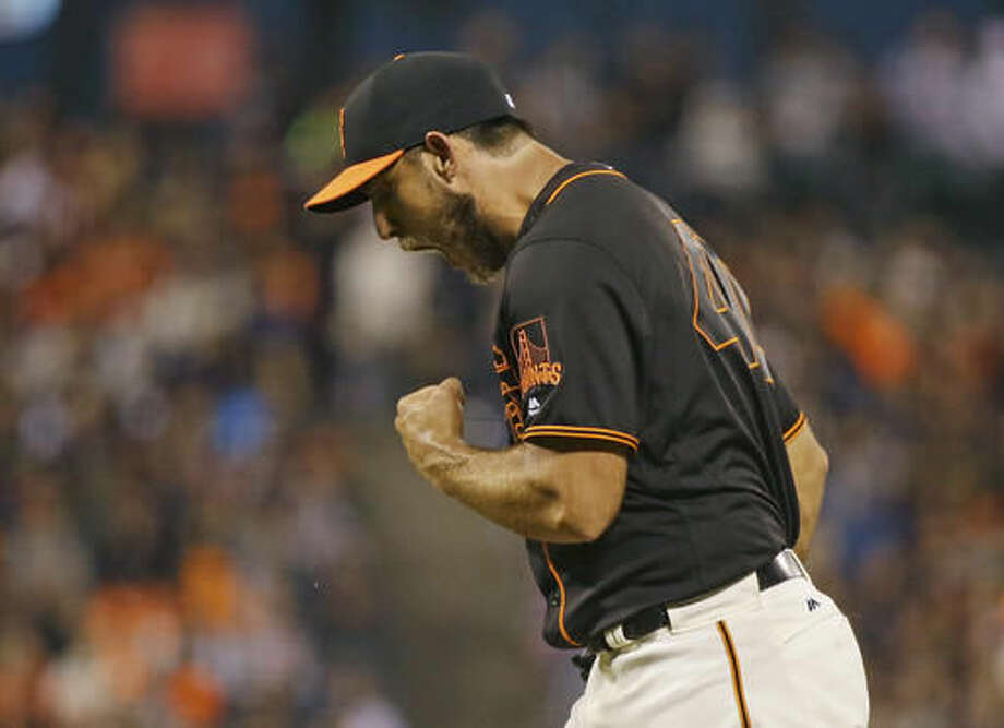 San Francisco Giants starting pitcher Madison Bumgarner reacts after Baltimore Orioles' Steve Pearce struck out swinging in the seventh inning of a baseball game Saturday, Aug. 13, 2016, in San Francisco. (AP Photo/Eric Risberg) Photo: Eric Risberg