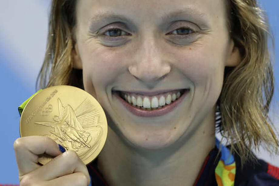 United States' Katie Ledecky shows off her gold medal in the women's 800-meter freestyle medals ceremony during the swimming competitions at the 2016 Summer Olympics, Friday, Aug. 12, 2016, in Rio de Janeiro, Brazil. (AP Photo/Michael Sohn) Photo: Michael Sohn