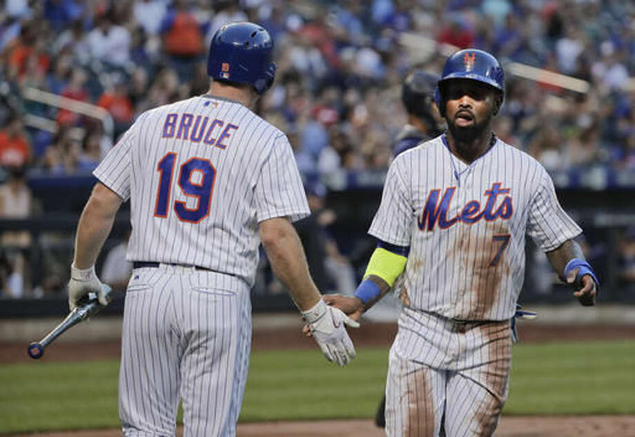 New York Mets'Jose Reyes (7) is greeted by Jay Bruce (19) after scoring on a base hit by Neil Walker against the San Diego Padres during the first inning of a baseball game, Saturday, Aug. 13, 2016, in New York. (AP Photo/Julie Jacobson) Photo: Julie Jacobson