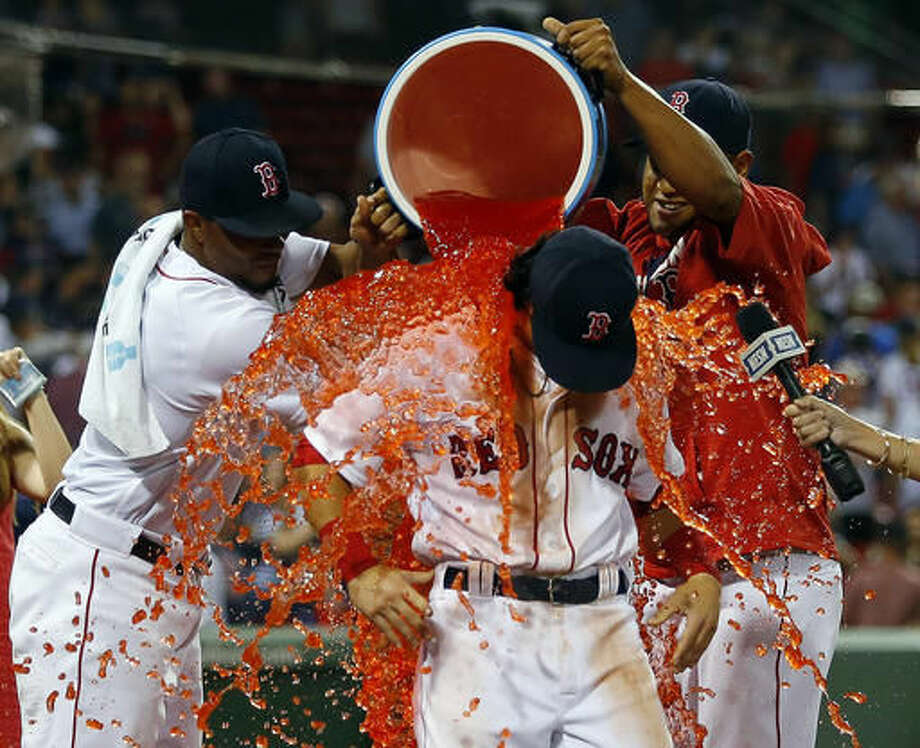 Boston Red Sox's Andrew Benintendi is doused after the team's 5-3 win over the New York Yankees in a baseball game at Fenway Park in Boston on Tuesday, Aug. 9, 2016. (AP Photo/Winslow Townson) Photo: Winslow Townson