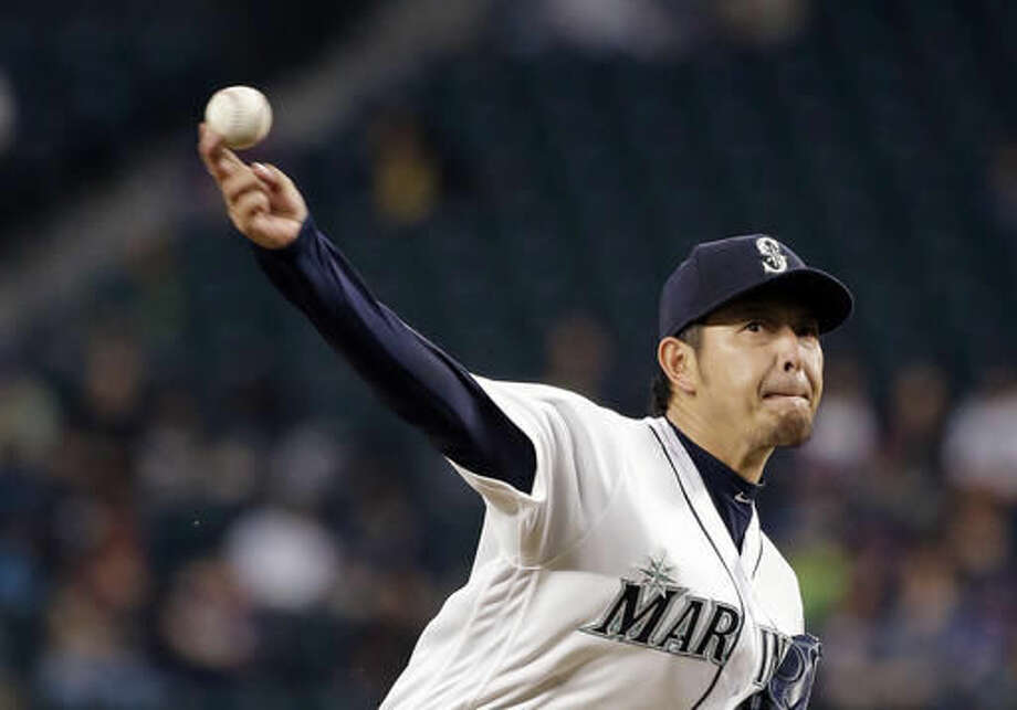 Seattle Mariners starting pitcher Hisashi Iwakuma throws against the Detroit Tigers in the fourth inning of a baseball game, Monday, Aug. 8, 2016, in Seattle. (AP Photo/Elaine Thompson) Photo: Elaine Thompson