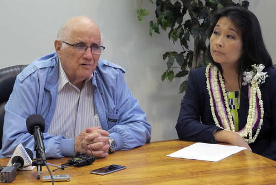 FILE - In this May 5, 2016 file photo, Hawaii House Speaker Joe Souki, left, and House Finance Chairwoman Sylvia Luke, right, talk to reporters at the state Capitol in Honolulu. Souki and Luke are running for re-election, and Luke, like 15 other candidates, is running unopposed. (AP Photo/Cathy Bussewitz, File) Photo: Cathy Bussewitz