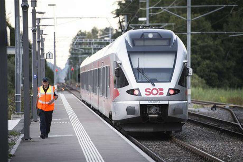 The train stands at the station after a man attacked other passengers aboard the train at Salez, Switzerland, on Saturday, Aug. 13, 2016. Police in Switzerland say a Swiss man set a fire and stabbed people on a train in the country's northeast, wounding six people some seriously, and injuring himself. (Gian Ehrenzeller / Keystone via AP) Photo: GIAN EHRENZELLER