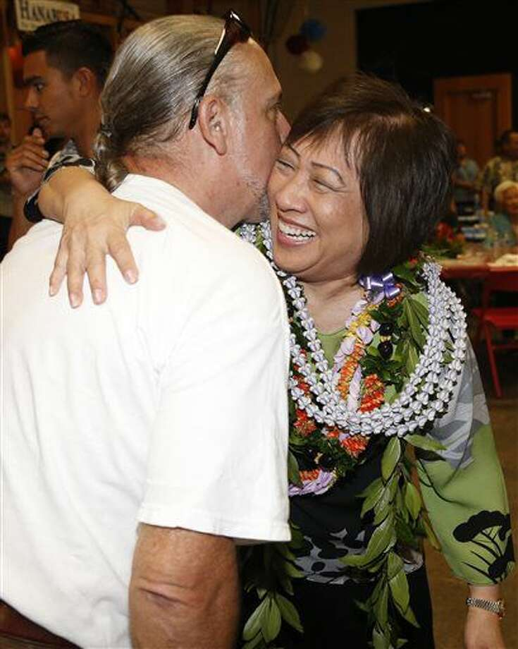 Former US Rep. Colleen Hanabusa, right, is congratulated by a supporter at her campaign headquarters, Saturday, August 13, 2016, in Honolulu. Hanabusa won the Democratic primary in Hawaii for her old House seat Saturday. The seat opened up when Rep. Mark Takai, D-Hawaii, died last month. (AP Photo/Marco Garcia) Photo: Marco Garcia