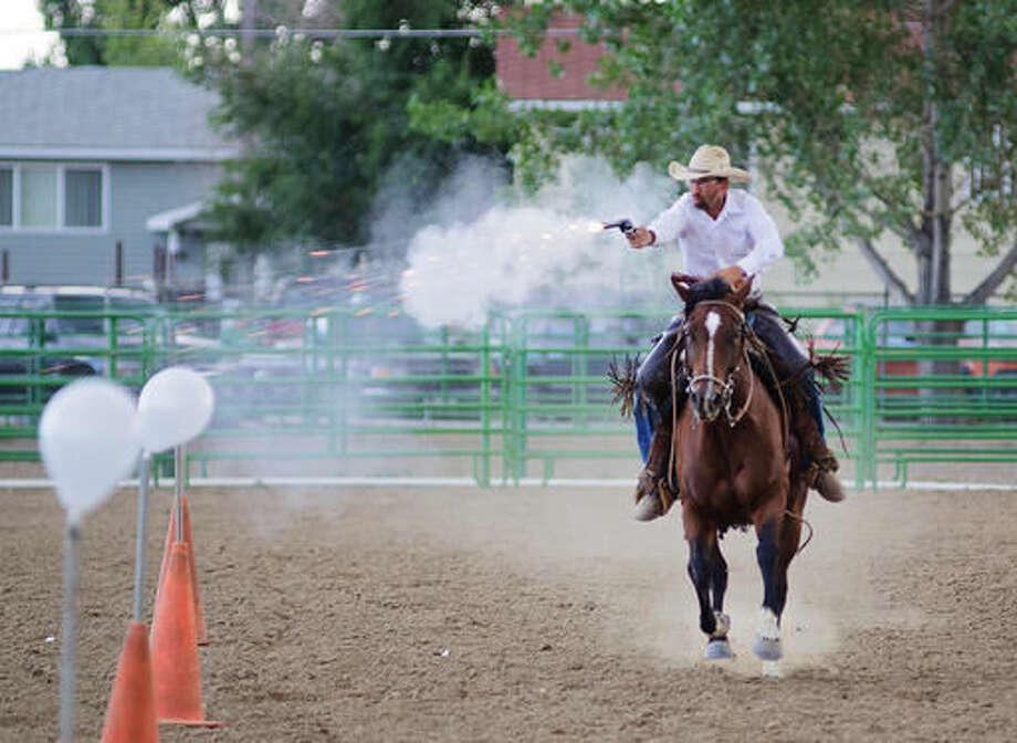 In this July 30, 2016, photo, Wyoming Desperados Mounted Shooters club vice president Mark Urlacher flies down the arena, popping balloons in rapid-fire succession at the end of the Wyoming Desperadosa mounted shooting demonstration at the Park County Fair in Powell, Wyo. (Matt Naber/The Powell Tribune via AP) MANDATORY CREDIT Photo: Matt Naber