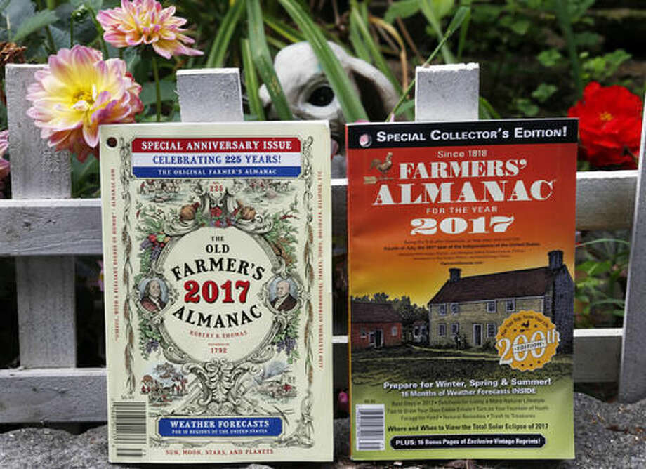 This Aug. 12, 2016, photo shows the 2017 editions of New Hampshire's Old Farmer's Almanac, left, and Maine's Farmers' Almanac photographed in Concord, N.H. The two publications, which will be released soon, are both celebrating milestones. Maine's 200th edition, and New Hampshire's 225th. (AP Photo/Jim Cole) Photo: Jim Cole