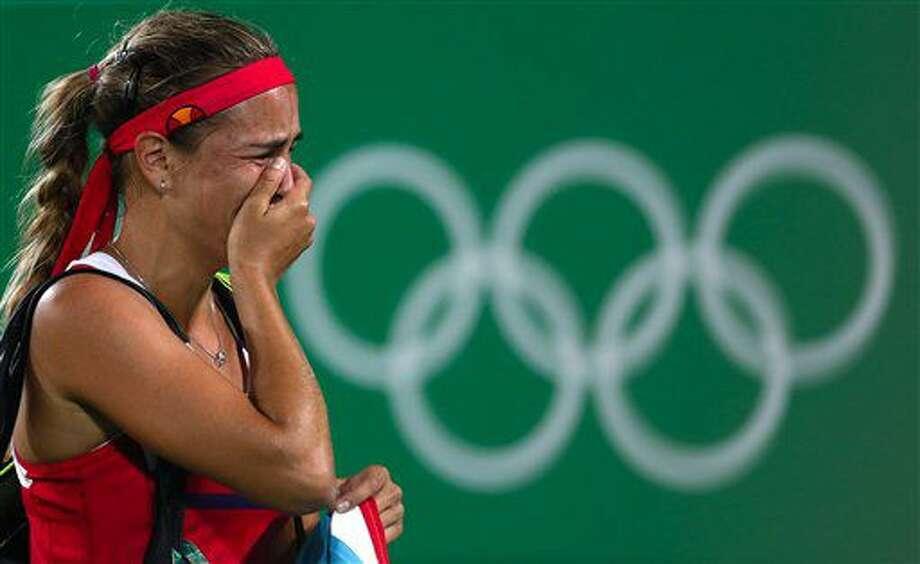 La puertorriqueña Mónica Puig llora tras ganar la medalla de oro en el tenis de mujeres de los Juegos Olímpicos de Río de Janeiro el sábado, 13 de agosto de 2016. (AP Photo/Vadim Ghirda) Photo: Vadim Ghirda