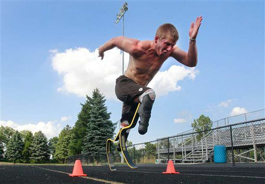 In this Monday, Aug. 1, 2016, photo, paralympian runner A.J. Digby takes off in a full sprint during a workout at the Eastwood High School track in Pemberville, Ohio. He will compete in the 2016 Paralympics in Rio de Janeiro. (Cameron Hart/The Blade via AP) Photo: Cameron Hart
