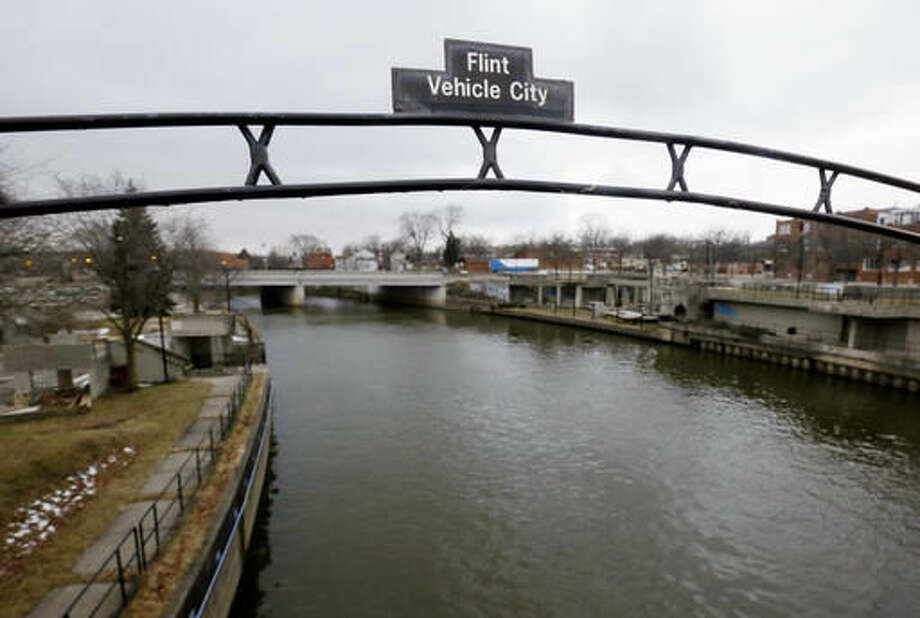 FILE - This Jan. 26, 2016, file photo shows a sign over the Flint River in Flint, Mich. Virginia Tech researchers who exposed the lead-tainted water problem in Flint, said Thursday, Aug. 11, 2016, the city's water quality has greatly improved, based on tests at more than 160 homes. (AP Photo/Carlos Osorio, File) Photo: Carlos Osorio