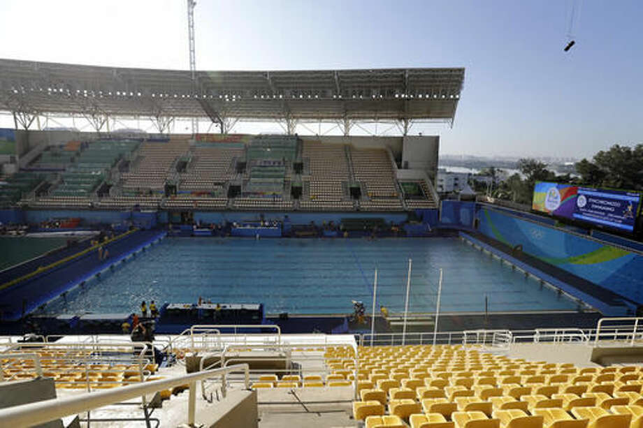 The pool in the Lenk Aquatic Center where the 2016 Summer Olympics synchronized swimming competition is held, is photographed after going through a change in water overnight, on Sunday, Aug. 14, 2016 in Rio de Janeiro, Brazil. Olympic officials gave up on cleaning the green-tinged water in one of the pools at the Maria Lenk Aquatics Center. Instead, they began draining it Saturday and planned to transfer nearly 1 million gallons of clear water from a nearby practice pool in time for the start of synchronized swimming. (AP Photo/Wong Maye-E) Photo: Wong Maye-E