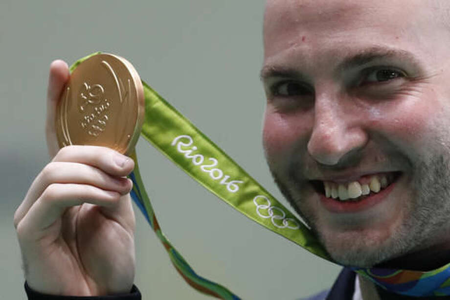 Niccolo Campriani of Italy shows off his gold medal during the victory ceremony for the men's 50-meter rifle 3 positions finals at the Olympic Shooting Center at the 2016 Summer Olympics in Rio de Janeiro, Brazil, Sunday, Aug. 14, 2016. (AP Photo/Hassan Ammar) Photo: Hassan Ammar