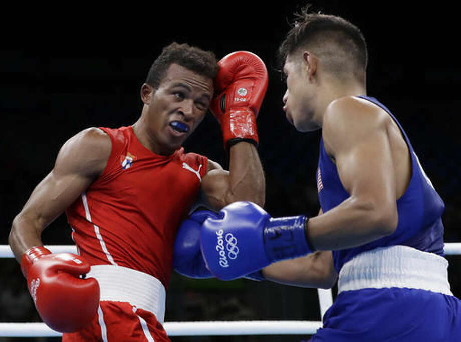 United State's Carlos Zenon Balderas Jr., right, fights Cuba's Lazaro Alvarez during a men's lightweight 60-kg quarterfinals boxing match at the 2016 Summer Olympics in Rio de Janeiro, Brazil, Friday, Aug. 12, 2016. (AP Photo/Frank Franklin II) Photo: Frank Franklin II