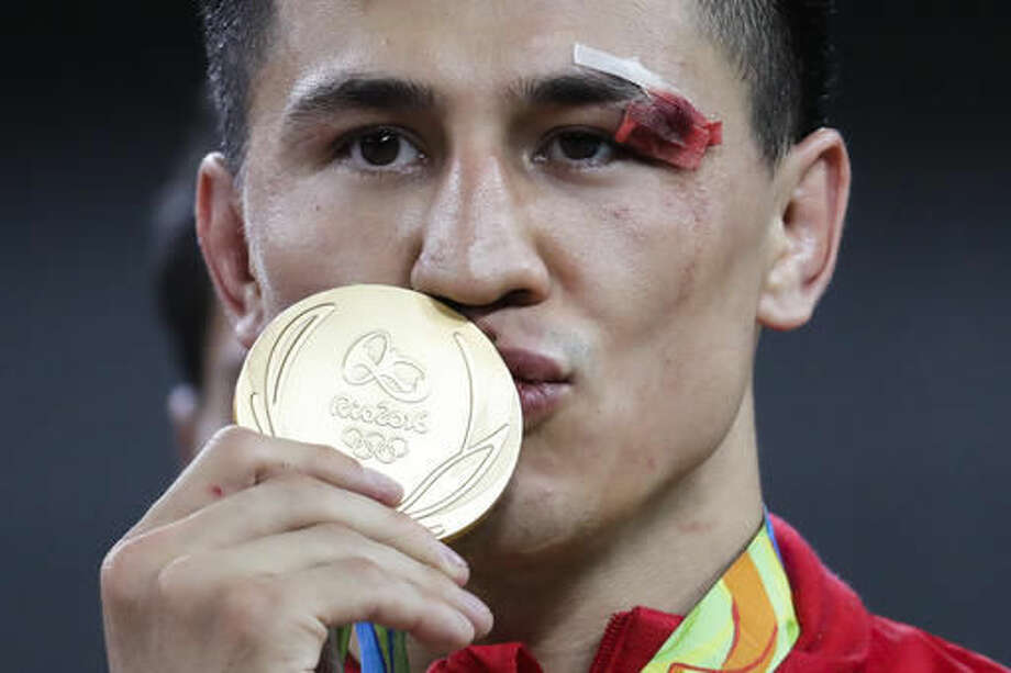 Gold medalist Russia's Roman Vlasov celebrates during the winners ceremony for the men's wrestling Greco-Roman 75-kg competition at the 2016 Summer Olympics in Rio de Janeiro, Brazil, Sunday, Aug. 14, 2016. (AP Photo/Markus Schreiber) Photo: Markus Schreiber