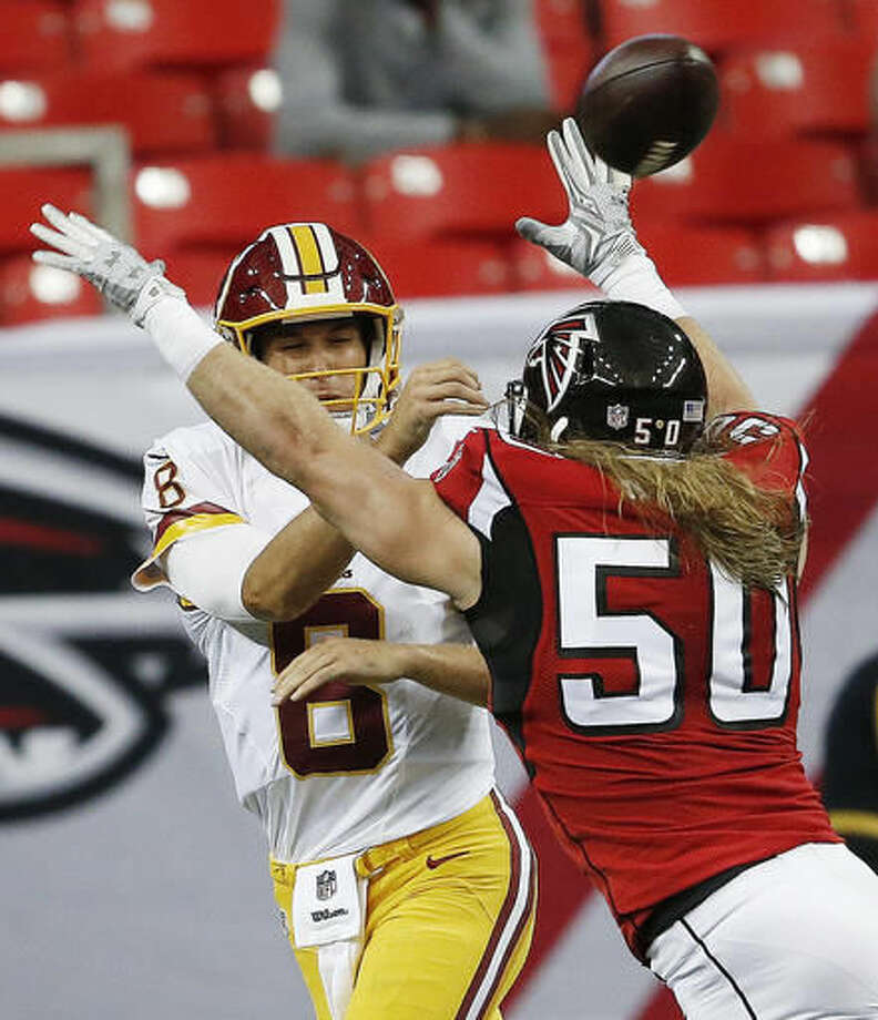 Washington Redskins quarterback Kirk Cousins (8) passes the ball against Atlanta Falcons outside linebacker Brooks Reed (50) during the first half of a preseason NFL football game, Thursday, Aug. 11, 2016, in Atlanta. (AP Photo/John Bazemore) Photo: John Bazemore