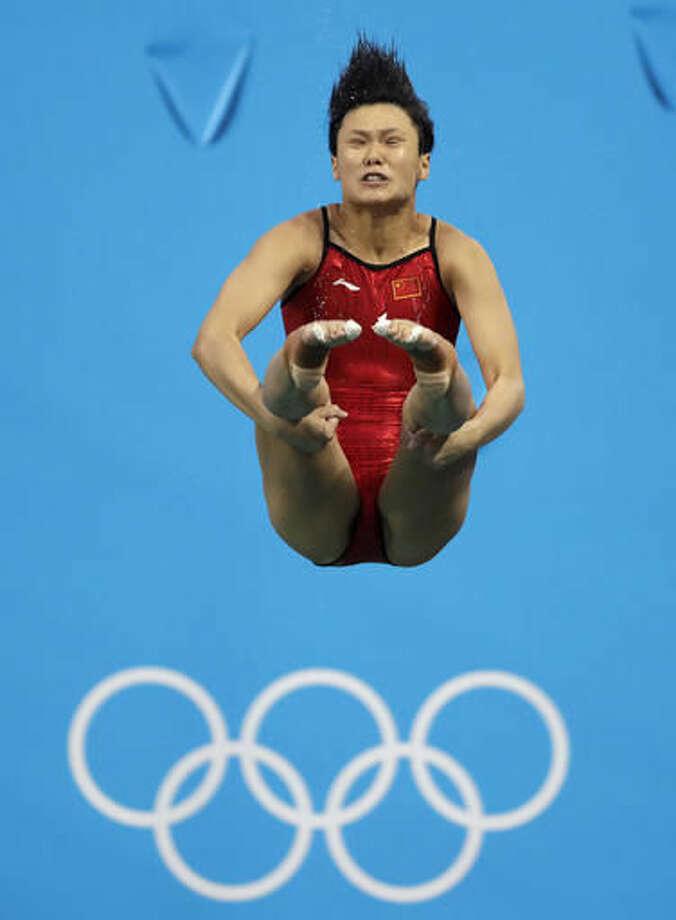 China's Shi Tingmao competes during the women's 3-meter springboard diving final in the Maria Lenk Aquatic Center at the 2016 Summer Olympics in Rio de Janeiro, Brazil, Sunday, Aug. 14, 2016. (AP Photo/Wong Maye-E) Photo: Wong Maye-E