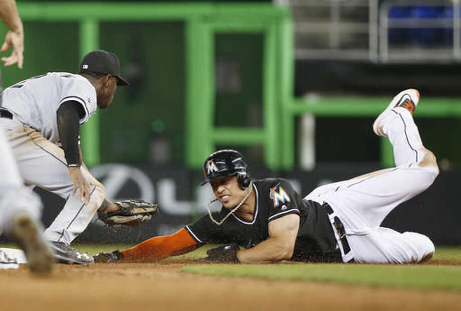 Chicago White Sox shortstop Tim Anderson, left, tags out Miami Marlins' Giancarlo Stanton who was attempting to reach second base during the ninth inning of a baseball game, Saturday, Aug. 13, 2016, in Miami. (AP Photo/Wilfredo Lee) Photo: Wilfredo Lee