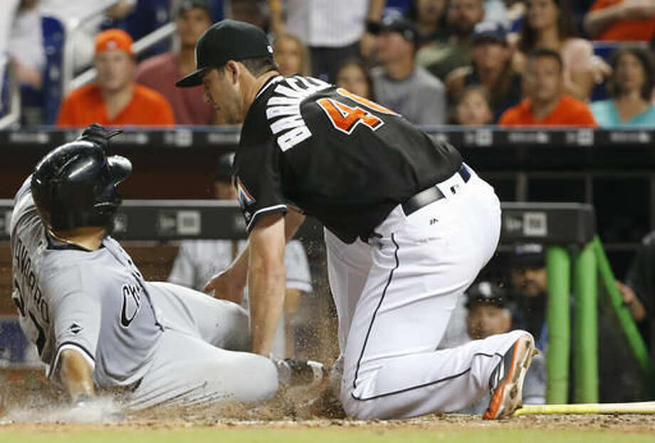 Chicago White Sox's Dioner Navarro slides into home for the go-ahead run as Miami Marlins relief pitcher Kyle Barraclough is unable to hang onto the ball during the eighth inning of a baseball game, Saturday, Aug. 13, 2016, in Miami. (AP Photo/Wilfredo Lee) Photo: Wilfredo Lee
