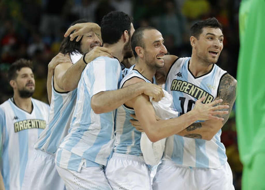Argentina's Manu Ginobili, center, and Argentina's Carlos Delfino, right, celebrate with teammates after their win over Brazil in a men's basketball game at the 2016 Summer Olympics in Rio de Janeiro, Brazil, Saturday, Aug. 13, 2016. (AP Photo/Eric Gay) Photo: Eric Gay