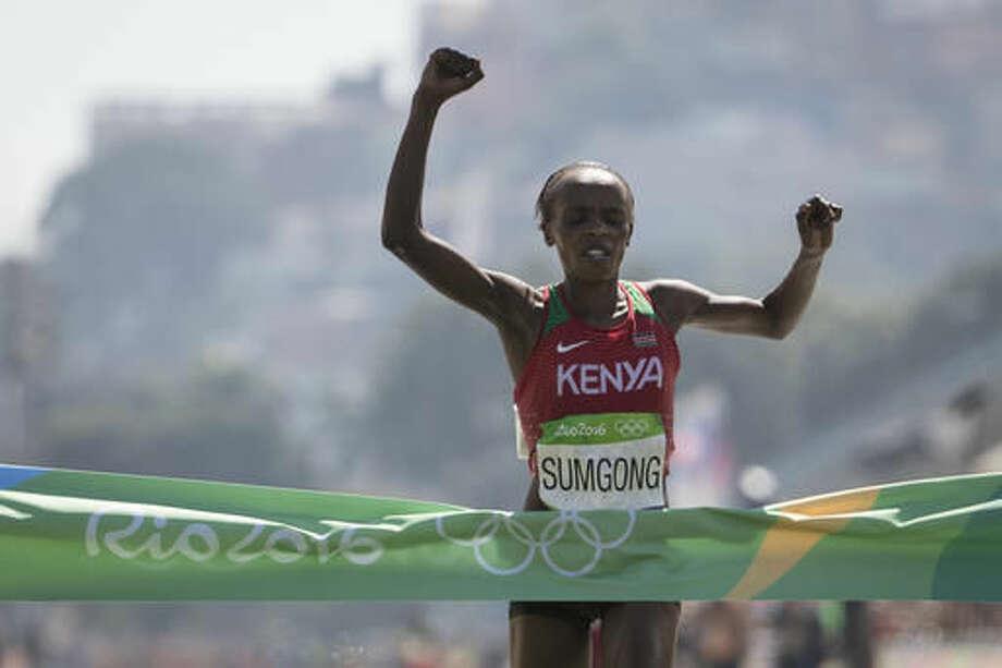 Jemima Jelagat Sumgong, of Kenya, celebrates as she crosses the finish line to win the womens marathon at the 2016 Summer Olympics in Rio de Janeiro, Brazil, Sunday, Aug. 14, 2016. (AP Photo/Felipe Dana) Photo: Felipe Dana
