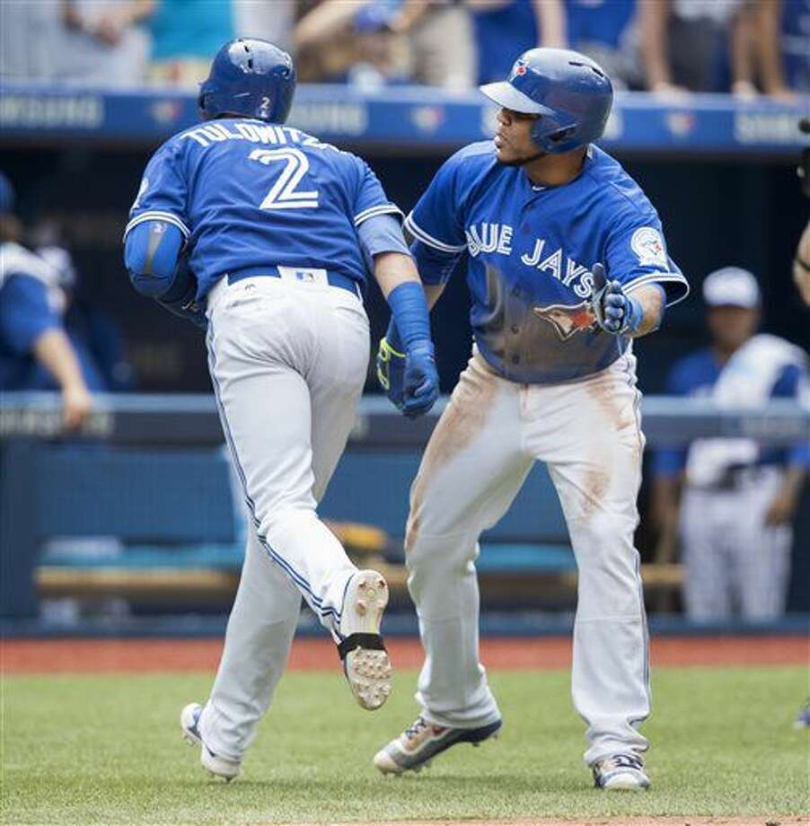 Toronto Blue Jays' Troy Tulowitzki is congratulated by teammate Edwin Encarnacion after he hit a two-run home run to score Encarnacion during the fifth inning of a baseball game against the Houston Astros on Sunday, Aug. 14, 2016, in Toronto. (Fred Thornhill/The Canadian Press via AP) Photo: Fred Thornhill