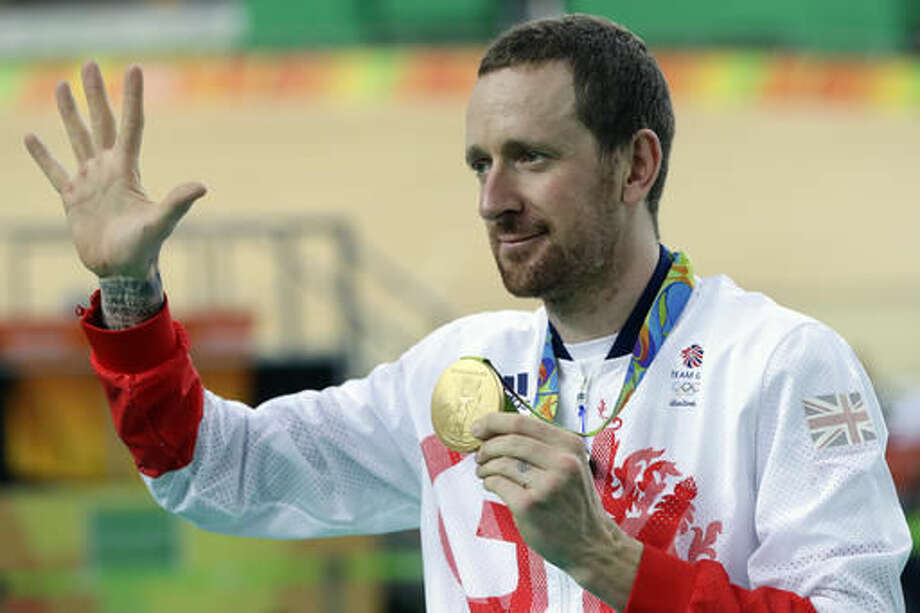 Gold medalist Bradley Wiggins of Britain poses on the podium of the Men's team pursuit final at the Rio Olympic Velodrome during the 2016 Summer Olympics in Rio de Janeiro, Brazil, Friday, Aug. 12, 2016. (AP Photo/Pavel Golovkin) Photo: Pavel Golovkin