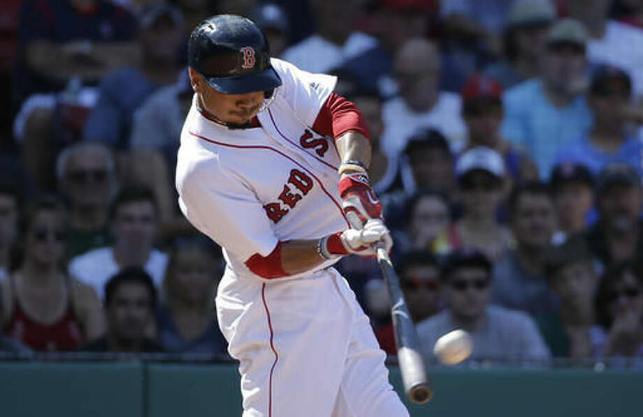 Boston Red Sox's Mookie Betts hits a three-run home run off a pitch by Arizona Diamondbacks' Adam Loewen in the fifth inning of a baseball game, Sunday, Aug. 14, 2016, in Boston. (AP Photo/Steven Senne) Photo: Steven Senne