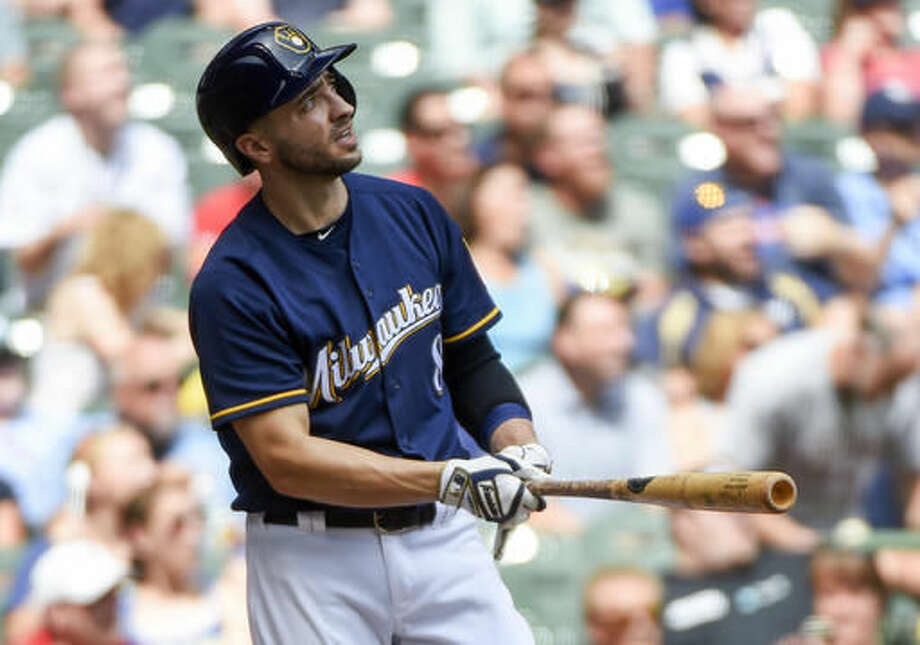 Milwaukee Brewers' Ryan Braun watches his three-run home run against Cincinnati Reds pitcher Cody Reed during the second inning of a baseball game Sunday, Aug. 14, 2016, in Milwaukee. (AP Photo/Benny Sieu) Photo: Benny Sieu