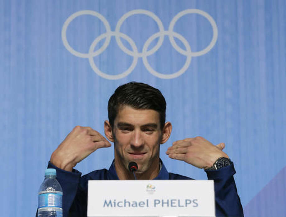United States' Olympic swimmer Michael Phelps gestures as he restates his intention to retire at a news conference at the 2016 Summer Olympics in Rio de Janeiro, Brazil, Sunday, Aug. 14, 2016. (AP Photo/Peter Morgan) Photo: Peter Morgan