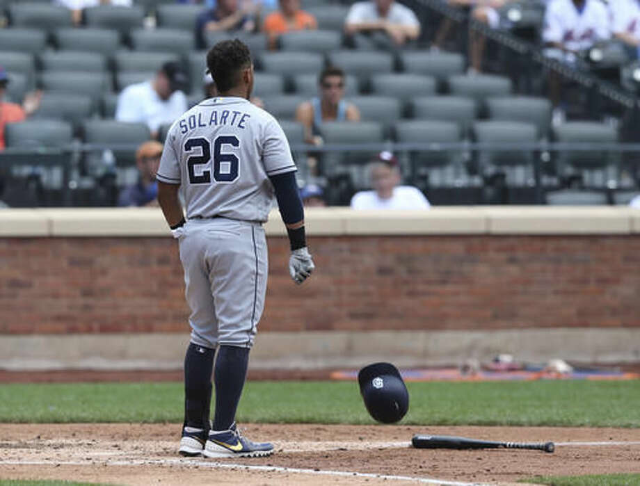 San Diego Padres' Yangervis Solarte throws his bat and helmet after striking out during the fourth inning of the baseball game against the New York Mets on Sunday, Aug. 14, 2016 in New York. (AP Photo/Seth Wenig) Photo: Seth Wenig