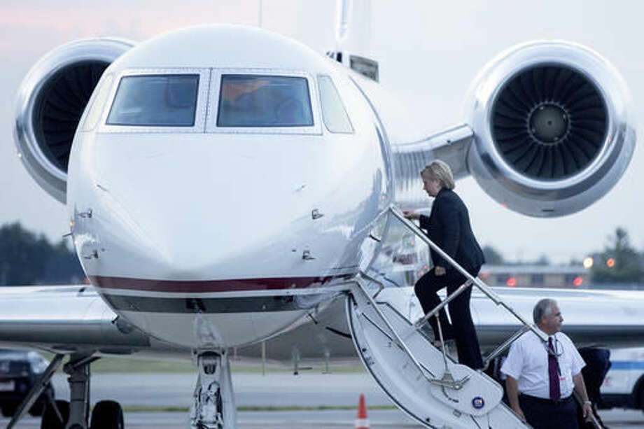 Democratic presidential candidate Hillary Clinton boards a plane at Chicago Midway International Airport, in Chicago, Thursday, Aug. 11, 2016, to travel to Westchester, N.Y. Clinton gave a speech on the economy after touring Futuramic Tool & Engineering in Warren, Mich., and attended a fundraiser in Chicago. (AP Photo/Andrew Harnik) Photo: Andrew Harnik